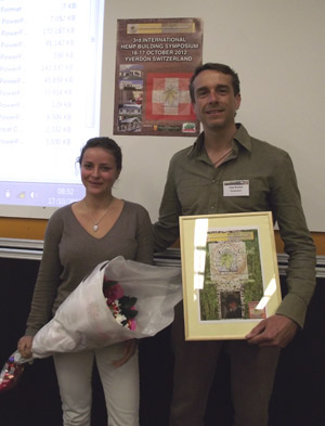 Elia Kühn and Tony Budden at the 3rd International Hemp Building Symposium.  Tony receiving the Yves Kühn Award.