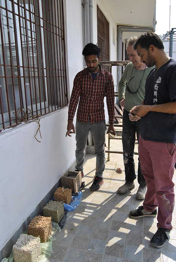 Ashesh, one of Nepals young Architects, with me and Dhiraj examining test blocks of Nepalese Hempcrete