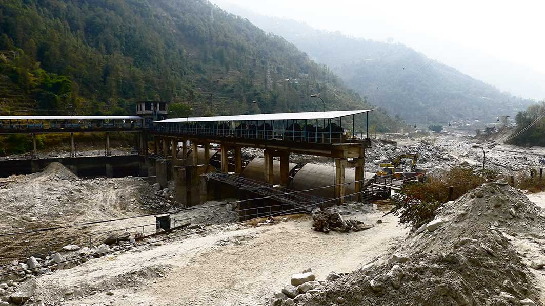 Hydro-electric generator wrecked by massive landslide upstream.